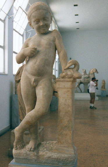 statuette of a naked boy with a duck he leans against a colon te